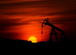 Oil rises on stronger financial markets, expectations of extended supply cuts
